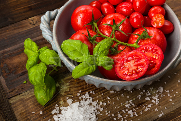 Fresh tomatoes in a bowl Stock photo © Moradoheath