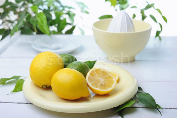 Citrus squeezer and fresh lemons being used to make fresh lemonade Stock photo © Moravska