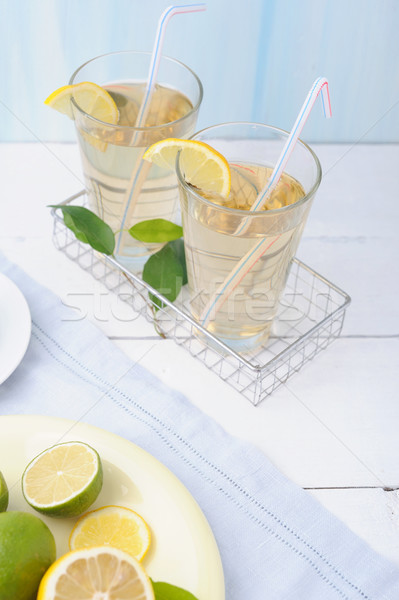 Bowl with fresh lime and lemon and two glass of lemonade on white wooden background Stock photo © Moravska