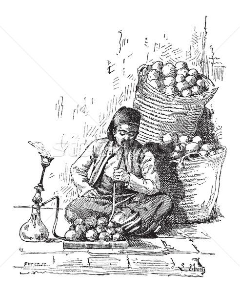 Vízipipa klasszikus vésés férfi dohányzás gravírozott Stock fotó © Morphart
