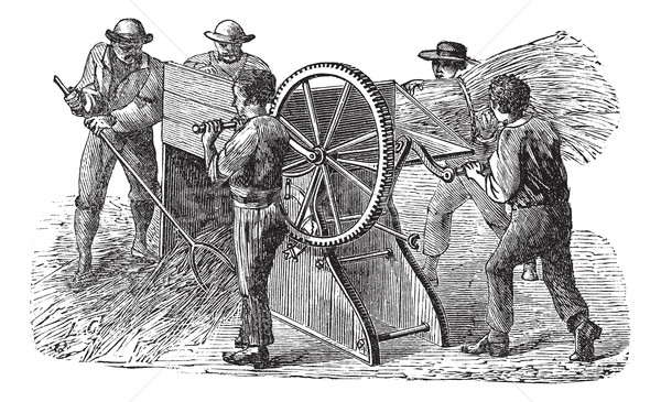 Five people using threshing machine also known as  thrashing mac Stock photo © Morphart