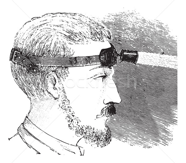Man with electric light attached to strap on forehead, vintage e Stock photo © Morphart
