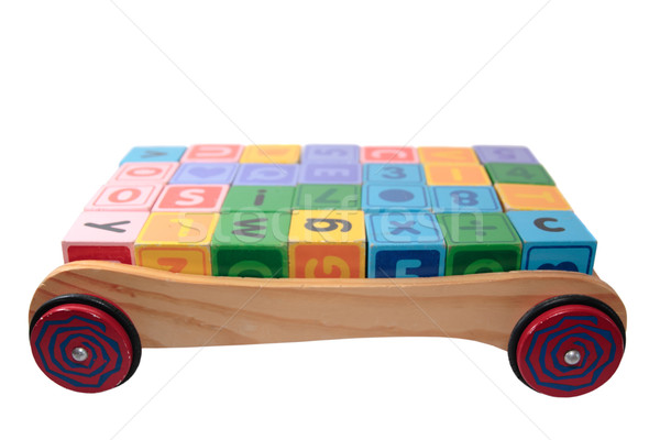 childrens play blocks in back of wooden trolley isolated on whit Stock photo © morrbyte
