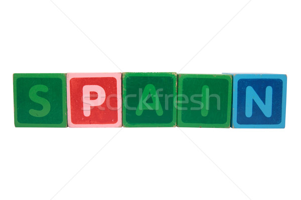 spain in toy block letters Stock photo © morrbyte