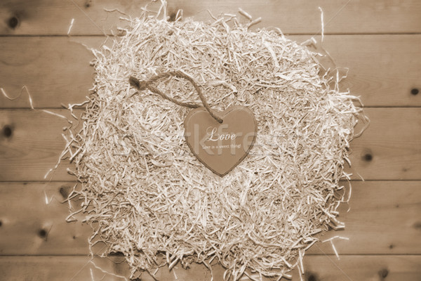 lone sepia heart in a love nest  Stock photo © morrbyte