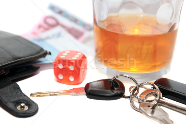 whiskey keys dice and money Stock photo © morrbyte