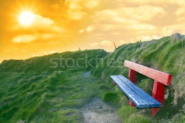 Stock photo: bench on a cliff edge at sunset