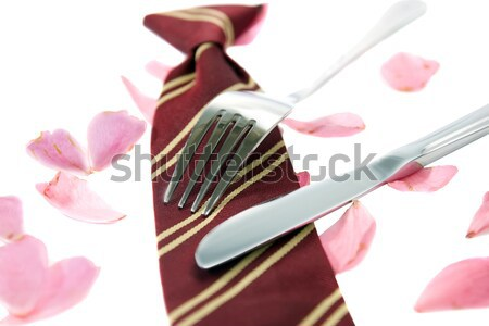 gold and silver forks surrounding heart shape with rose petals Stock photo © morrbyte