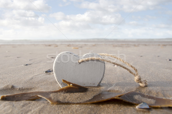 wooden love heart in the sand Stock photo © morrbyte