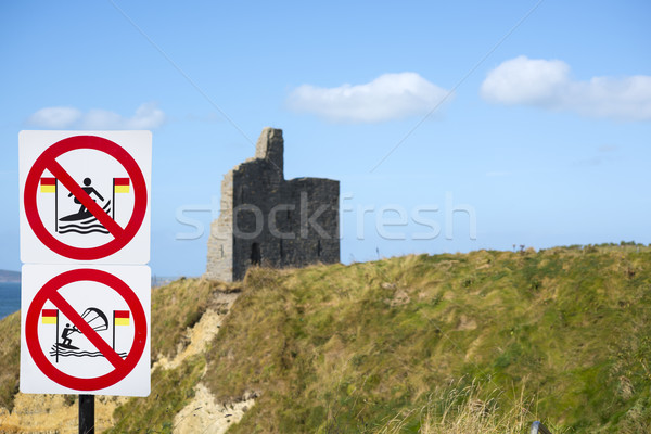 Stock photo: warning signs for surfers at ballybunion castle on the wild atlantic way in ireland