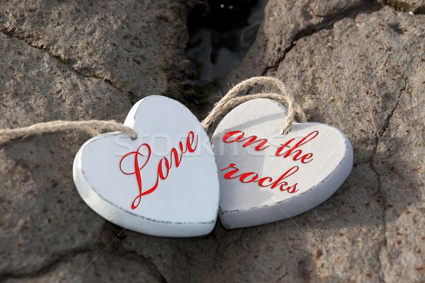 love on the rocks wooden hearts Stock photo © morrbyte