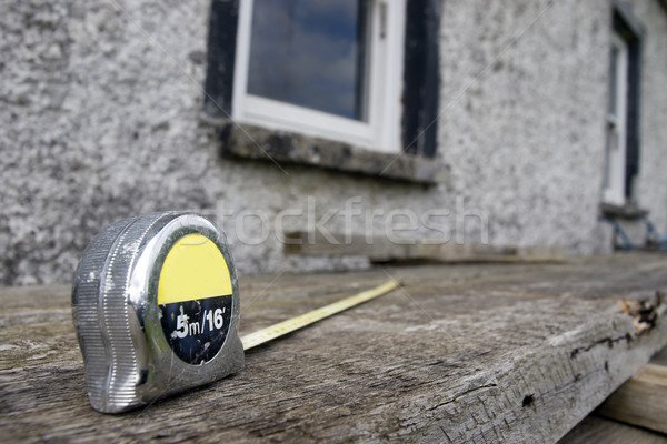 builders diy tape measure on scaffolding at building site Stock photo © morrbyte