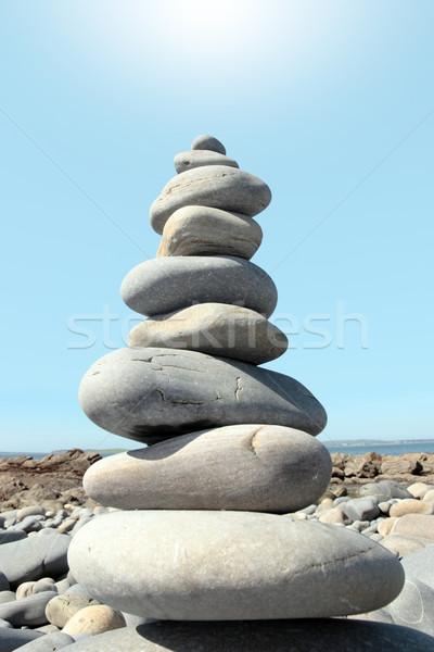 Forró kiegyensúlyozott kövek higgadt spirituális tengerpart Stock fotó © morrbyte