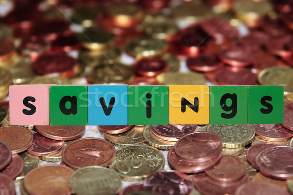 coin savings in toy letters Stock photo © morrbyte