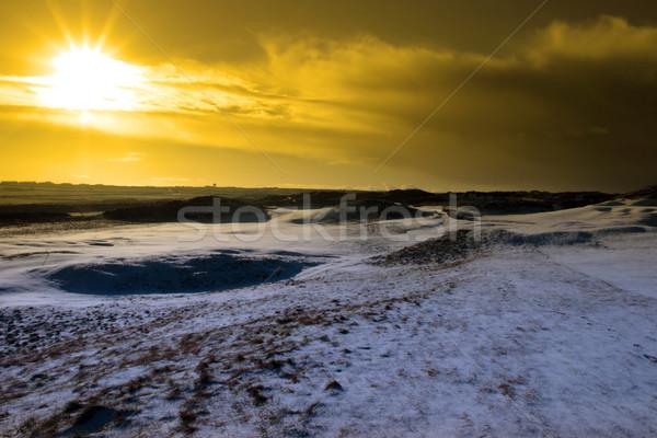 Czerwony niebo zachód słońca śniegu pokryty linki Zdjęcia stock © morrbyte