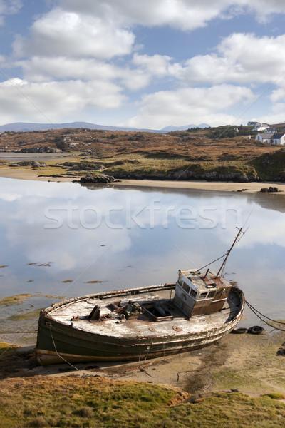 old fishing boat beached on Irish beach Stock photo © morrbyte