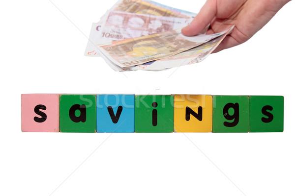 Pénz megtakarított pénz játék levelek fehér vágási körvonal Stock fotó © morrbyte