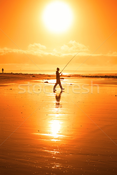 lone fisherman fishing on the Kerry beach Stock photo © morrbyte