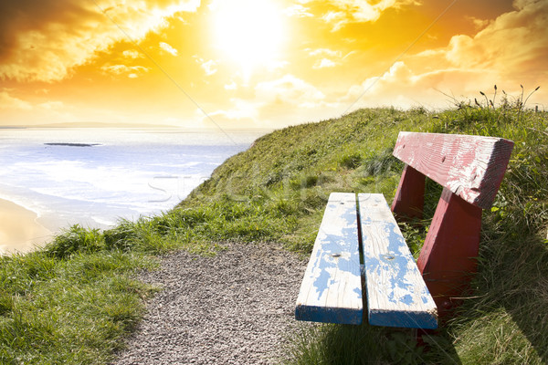 view of beach and Atlantic Ocean in Ballybunion with bench Stock photo © morrbyte