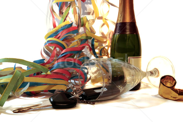 fallen champagne glass and car keys Stock photo © morrbyte