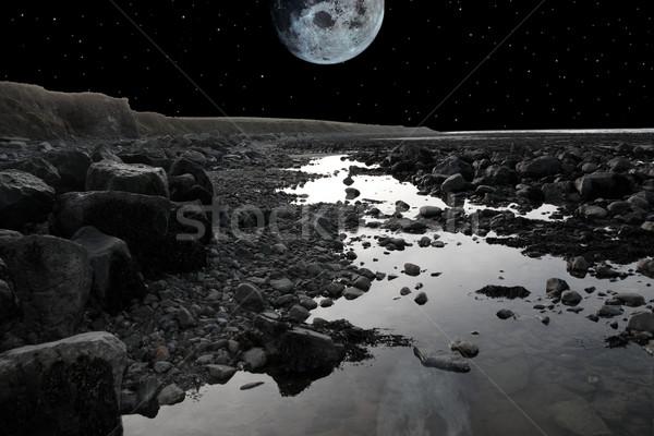 Telihold tengerpart szürke kövek Írország hideg Stock fotó © morrbyte