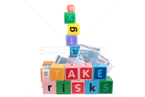 Stock photo: take risks with childs letter play blocks