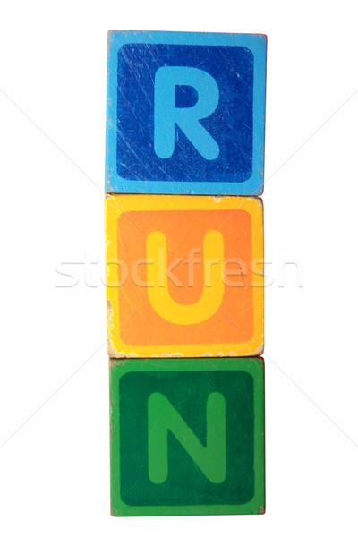 Eseguire giocattolo lettere bianco Foto d'archivio © morrbyte
