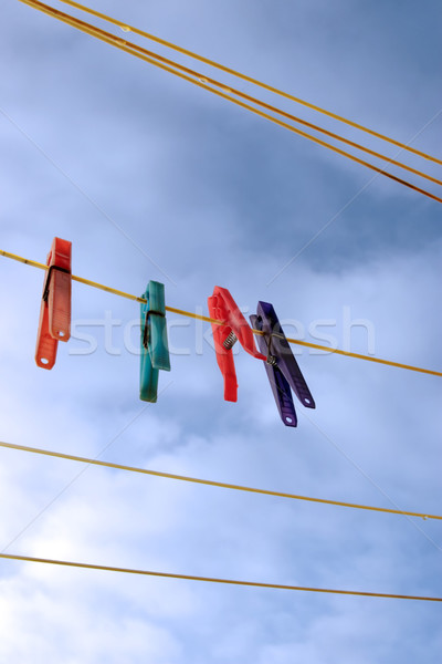 pegs on a wet washing line Stock photo © morrbyte
