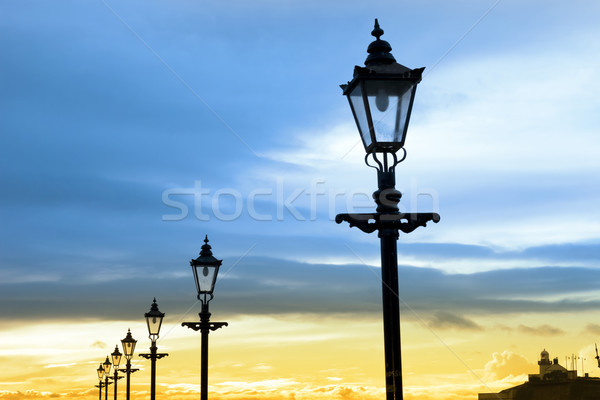 lighthouse and row of vintage lamps Stock photo © morrbyte