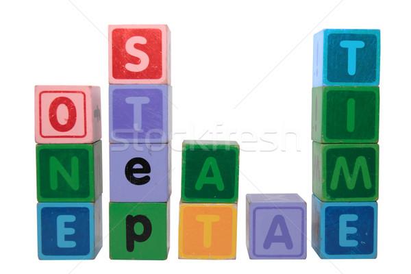 Uno passo tempo giocattolo lettere Foto d'archivio © morrbyte