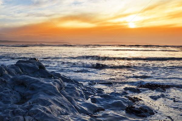 Azul rochas praia reflexões maneira Foto stock © morrbyte