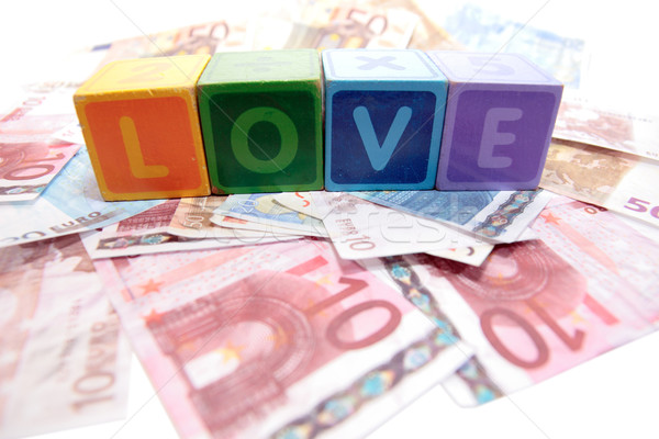 love in toy play block letters with cash Stock photo © morrbyte