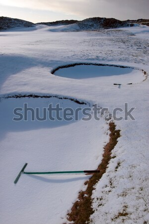 rakes in bunkers at dawn on a snow covered links golf course Stock photo © morrbyte