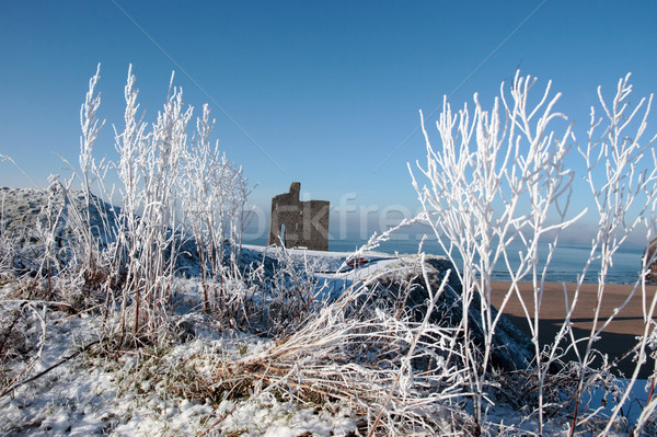 Stock photo: christmas season view of ballybunion castle and beach in snow