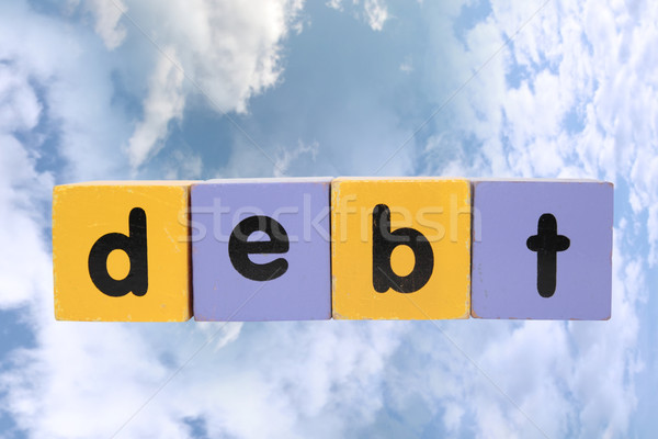 debt in toy play block letters with clipping path on clouds Stock photo © morrbyte
