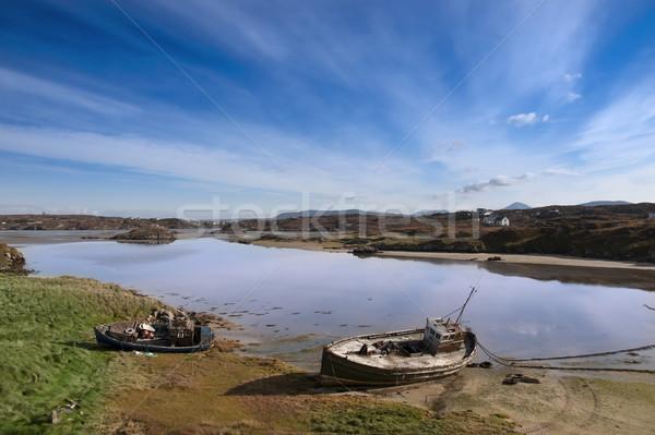 two beached fishing boats on Irish beach Stock photo © morrbyte