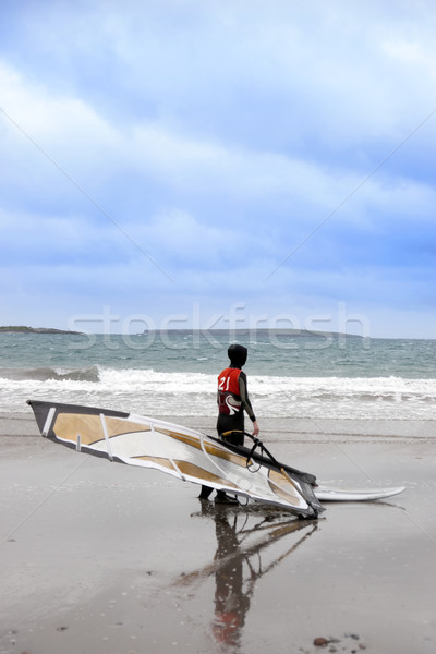 lone Atlantic way windsurfer getting ready to surf Stock photo © morrbyte