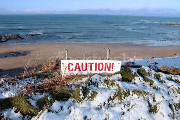 red caution sign on cliffs dangerous slippery edge Stock photo © morrbyte