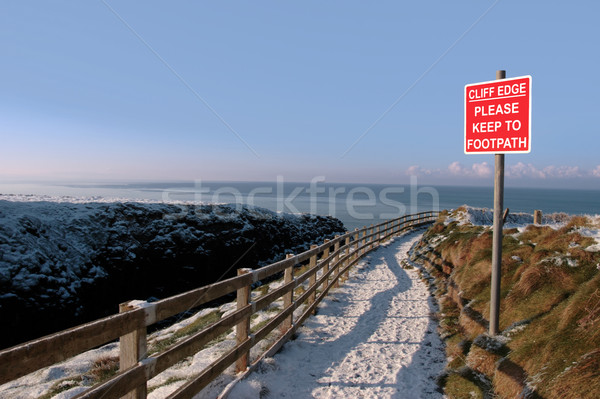 warning sign on a winter snow cliff walk Stock photo © morrbyte