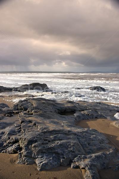 black rocks on Ballybunion beach Stock photo © morrbyte