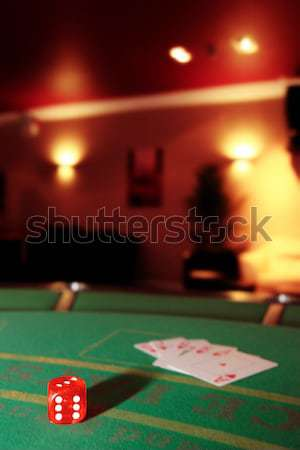 Stock photo: dice with the jack of spades in the pack