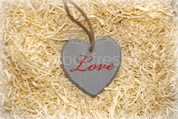 love heart in grey within a love nest Stock photo © morrbyte