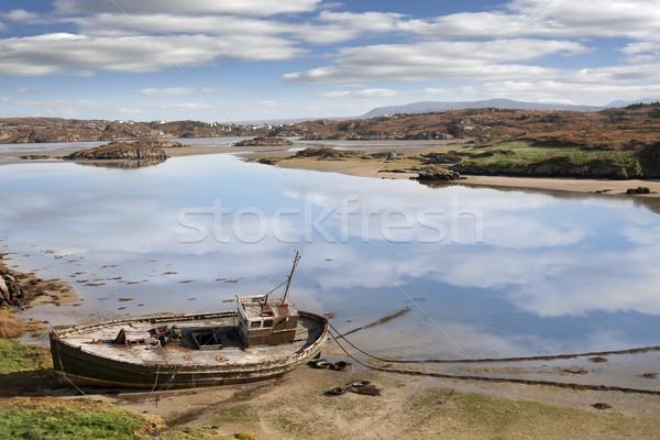 old beached fishing boat on Irish beach Stock photo © morrbyte