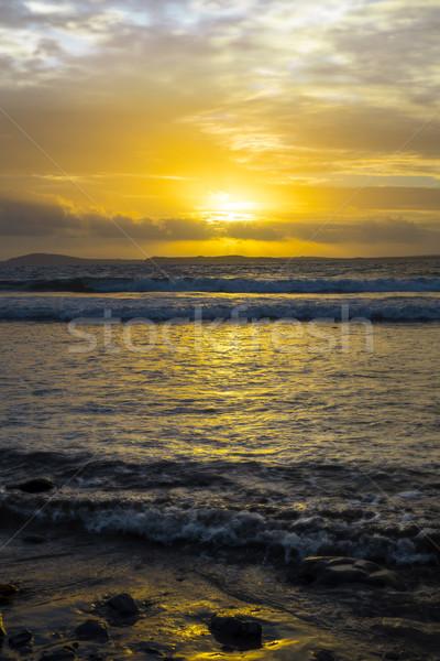 Bella giallo tramonto soft onde spiaggia Foto d'archivio © morrbyte