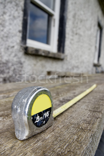builders diy tape measure at building site Stock photo © morrbyte