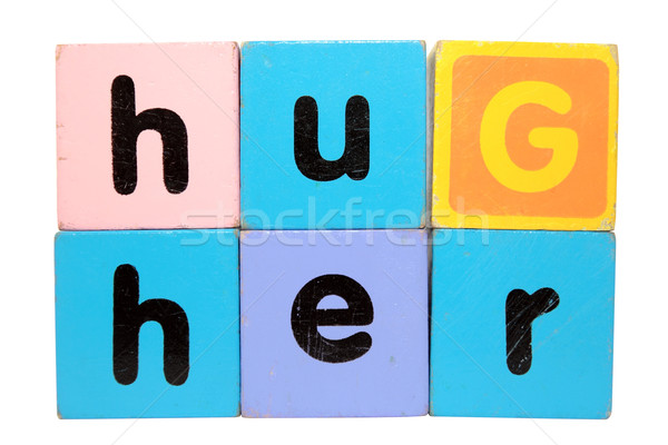 hug her in toy play block letters with clipping path on white Stock photo © morrbyte