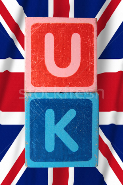 Stock photo: uk and flag in toy block letters