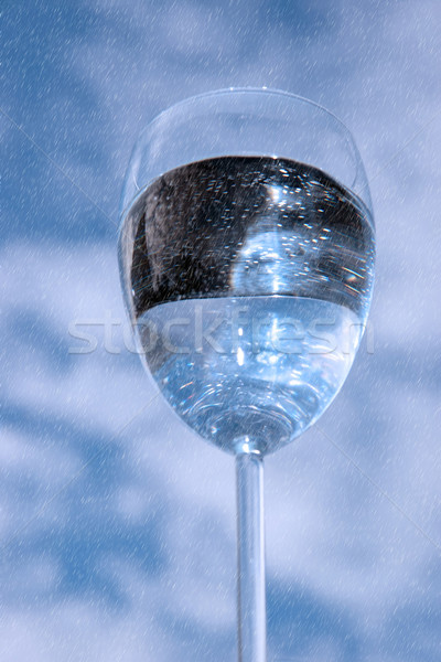 glass of water against a sky while raining Stock photo © morrbyte