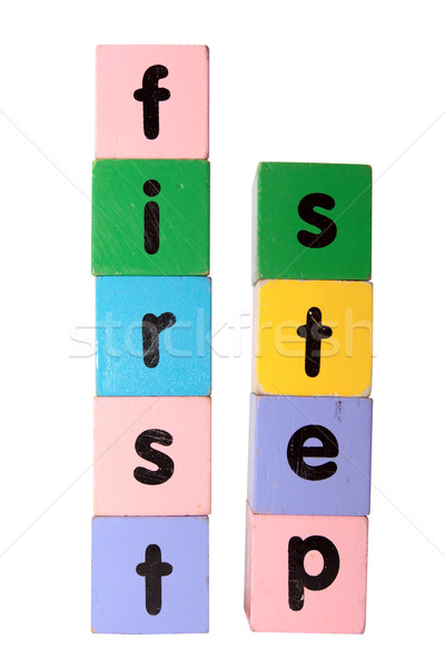 first step in wooden play block letters with clipping path Stock photo © morrbyte
