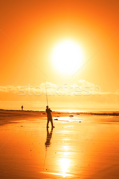 lone fisherman fishing on the Ballybunion beach Stock photo © morrbyte